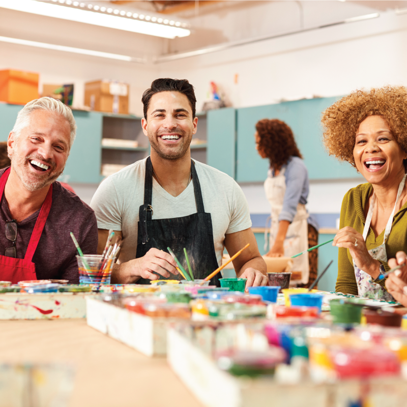 Residents participating in an art class using paints