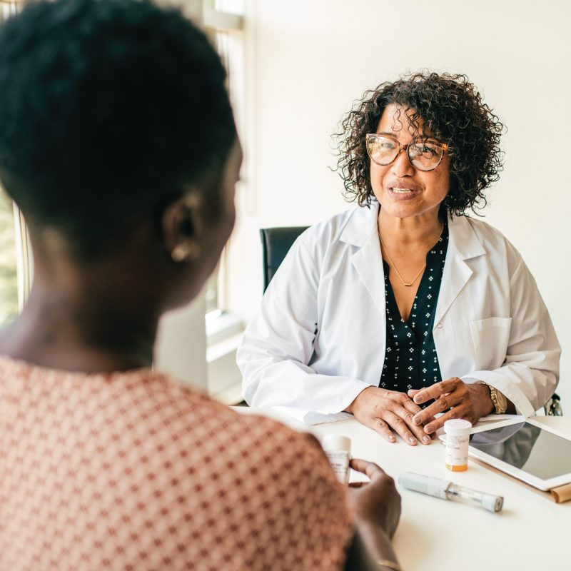 Female resident in a one-on-one meeting with a female physician